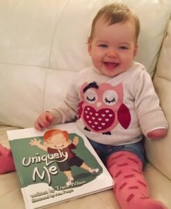 baby holding uniquely me childrens book by trace wilson